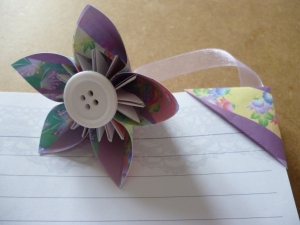 Small triangular bookmark with kusudama attached by ribbon