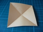 Fold diagonally from corner to corner, twice