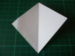 18. Have the white side facing up, and fold from one corner to the other