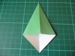 19. Fold the other two corners towards the middle so that the edges line up with the middle line